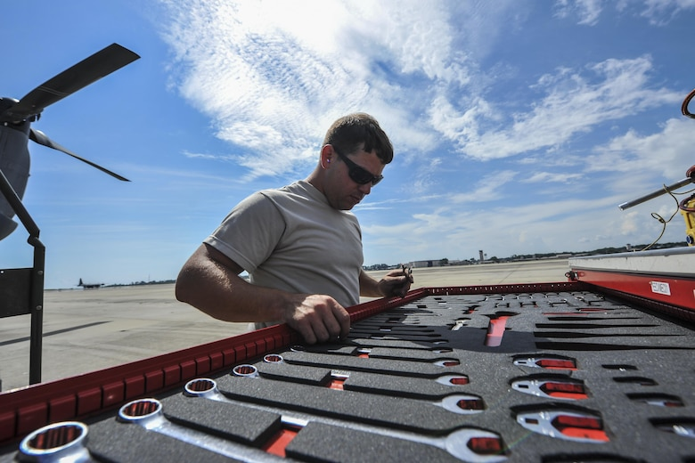 Airman 1st Class Curtis Masenheimer, a crew chief with the 801st Special Operations Aircraft Maintenance Squadron, gathers tools to perform maintenance on a CV-22 Osprey at Hurlburt Field, Fla., Sept. 27, 2016. Crew chiefs with the 801st SOAMXS are trained to diagnose malfunctions on the Osprey during pre and post-flight inspections, repair and refuel the aircraft, keep detailed records and ensure the aircraft are mission ready at all times. (U.S. Air Force photo by Airman 1st Class Joseph Pick)