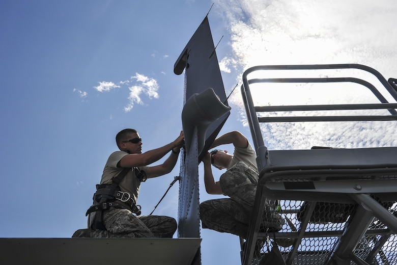 Staff Sgt. Jonathan Knutson, left, and Airman 1st Class Curtis Masenheimer, crew chiefs with the 801st Special Operations Aircraft Maintenance Squadron, perform maintenance on the tail of a CV-22 Osprey at Hurlburt Field, Fla., Sept. 27, 2016. Crew chiefs with the 801st SOAMXS are trained to diagnose malfunctions on the Osprey during pre and post-flight inspections, repair and refuel the aircraft, keep detailed records and ensure the aircraft are mission ready at all times. (U.S. Air Force photo by Airman 1st Class Joseph Pick)