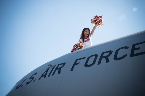 Katrina (team policy dictates that she doesn't share her last name), National Football League cheerleader from the Kansas City Chiefs, waves from the top of a C-130J Super Hercules. She and three of her teammates visited Keesler Air Force Base as art of an event hosted by the Army and Air Force Exchange Service that included a tour of the base, a Chiefs' Cheerleader clinic for children at the Youth Center and a fashion show at the main Exchange. (U.S. Air Force photo/Senior Airman Heather Heiney)