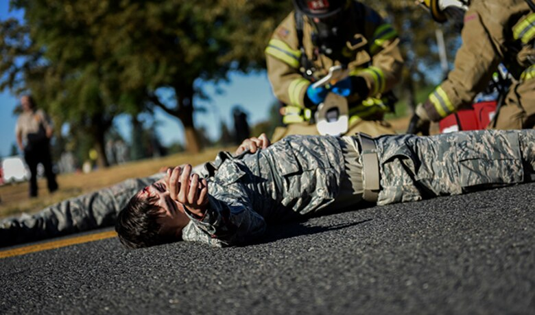 A Team Fairchild Airman plays as a victim of a vehicle crash during an Emergency Management Exercise Sept. 27, 2016, at Fairchild Air Force Base, Wash. One of the primary goals of the 92nd Air Refueling Wing and 141st ARW Inspector General office is to make all of the exercises conducted on base as realistic as possible. (U.S. Air Force photo/Airman 1st Class Sean Campbell)