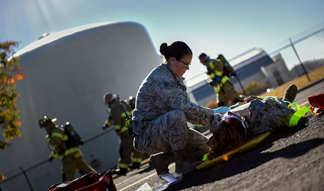 Senior Airman Julie Fink, 92nd Medical Operations Squadron aerospace medical technician, provides medical care to a simulated victim of a vehicle incident during an Emergency Management Exercise Sept. 27, 2016, at Fairchild Air Force Base, Wash. The 92nd Air Refueling Wing and 141st ARW Inspector Generals, 18 subject matter experts from various parts of the base, 30 Wing Inspection Team members and 14 actors from the 92nd ARW and 141st ARW participated in the exercise. (U.S. Air Force photo/Airman 1st Class Sean Campbell)