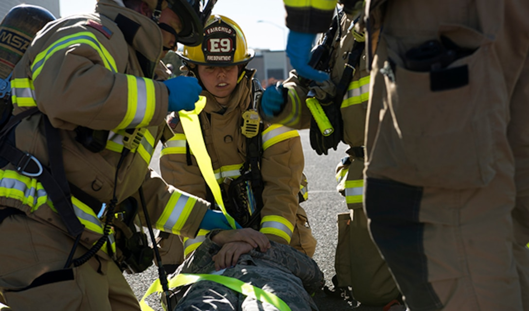 Team Fairchild firefighters secure a simulated victim for transport during an Emergency Management Exercise Sept. 29, 2016, at Fairchild Air Force Base, Wash. Fairchild firefighters work in tandem with the 92nd Medical Squadron's ambulance services emergency medical technicians to provide the base with rapid first response to emergencies. (U.S. Air Force photo/Airman 1st Class Ryan Lackey)