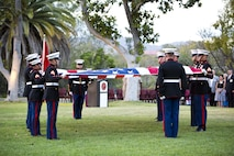 U. S. Marines with Marine Corps Installations West, Marine Corps Base Camp Pendleton, fold the American flag during the commanding general's evening colors ceremony at the historic Santa Margarita Ranch House on Camp Pendleton, Calif., Sept. 28, 2016. (U.S. Marine Corps photo by Sgt. Tabitha A. Markovich)