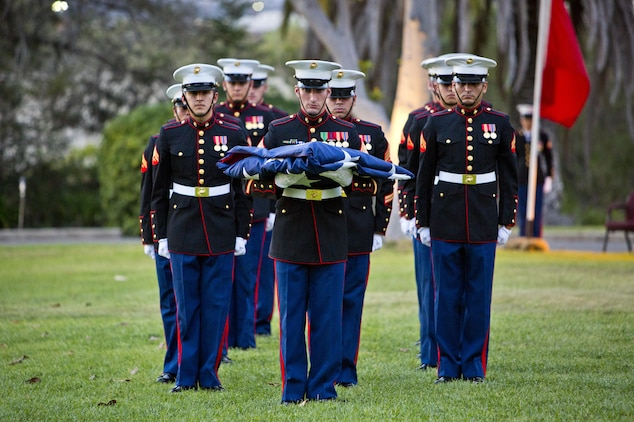 U. S. Marines with Marine Corps Installations West, Marine Corps Base Camp Pendleton, retire the colors during the commanding general's evening colors ceremony at the historic Santa Margarita Ranch House on Camp Pendleton, Calif., Sept. 28, 2016. (U.S. Marine Corps photo by Sgt. Tabitha A. Markovich)