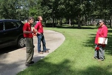 Larry McIntosh (L), John Nevels (C) and Sheron Belcher (R), quality assurance representatives, discuss the possible location of a Manufactured Housing Unit during a site inspection.  These Corps employees from the Huntsville Center are in southern Louisiana supporting the Federal Emergency Management Agency's temporary housing mission that stemmed from the Baton Rouge flood.