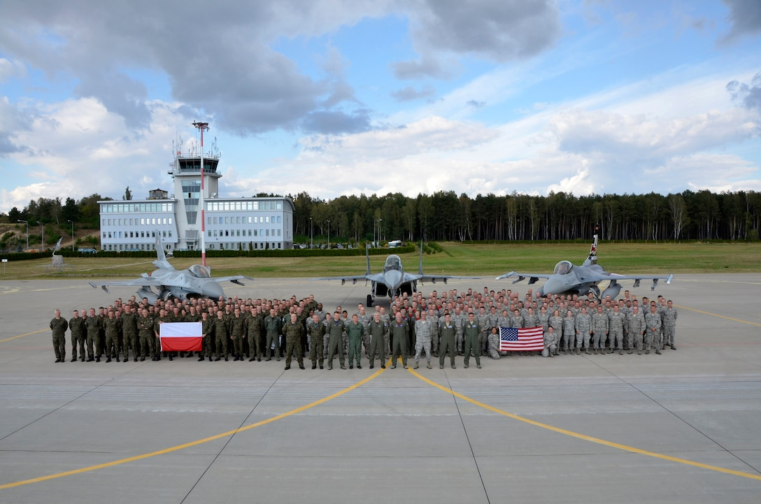 Members of the South Dakota Air National Guard, 52nd Operations Group Detachment 1, and the Polish air force, stand for a group photo at Lask Air Base, Poland, Sept. 22, 2016. The 114th Fighter Wing deployed more than 100 personnel in support of Aviation Detachment 16-4, a bilateral training exercise between the U.S. and Polish forces. The 114 FW was able to train alongside Polish allies in a variety of missions to include, close air support, air to air and air to ground. (U.S. Air National Guard photo by Capt. Amy Rittberger)