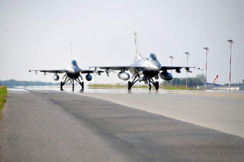 Two F-16 Fighting Falcons from the South Dakota Air National Guard arrive at Lask Air Base, Poland, Sept. 19, 2016, after completing a training mission. The 114th Fighter Wing deployed more than 100 personnel in support of Aviation Detachment 16-4, a bilateral training exercise between the U.S. and Polish forces. The 114 FW was able to train alongside Polish allies in a variety of missions to include, close air support, air to air and air to ground. (U.S. Air National Guard photo by Capt. Amy Rittberger)