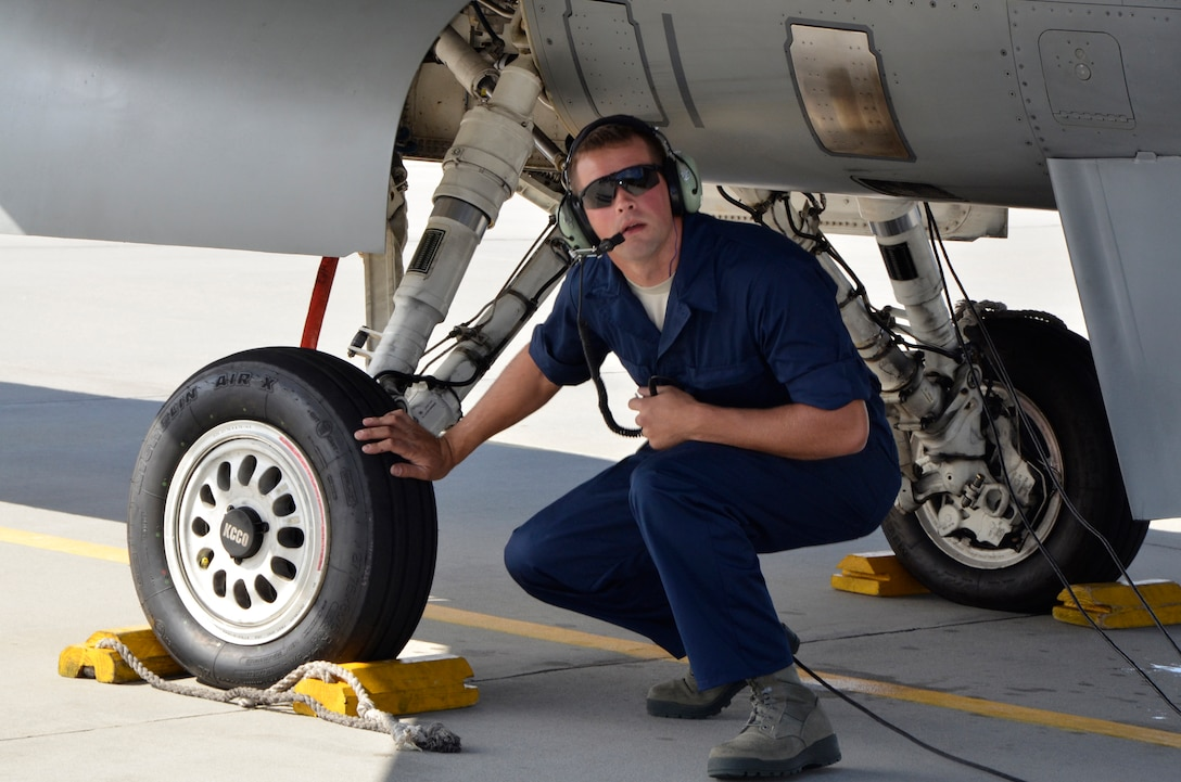 Senior Airman Alex Hickman, 114th Aircraft Maintenance Squadron crew chief, checks over an F-16 Fighting Falcon prior to take off at Lask Air Base, Poland, Sept. 16, 2016. The 114th Fighter Wing deployed more than 100 personnel in support of Aviation Detachment 16-4, a bilateral training exercise between the U.S. and Polish forces. The 114 FW was able to train alongside Polish allies in a variety of missions to include, close air support, air to air and air to ground. (U.S. Air National Guard photo by Capt. Amy Rittberger)