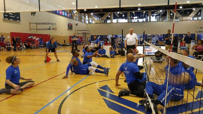 Tech. Sgt. Larry O'Neil and fellow wounded warriors compete in sitting volleyball at the Warrior Games trials in Las Vegas. (courtesy photo)