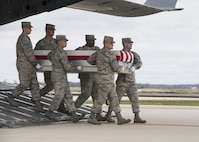 A U.S. Air Force carry team transfers the remains of Staff Sgt. Austin Bieren, of Umatilla, Ore., April 1, 2017, at Dover Air Force Base, Del. Bieren was assigned to the 21st Space Wing, Peterson AFB, Colo. (U.S. Air Force photo by Senior Airman Zachary Cacicia)