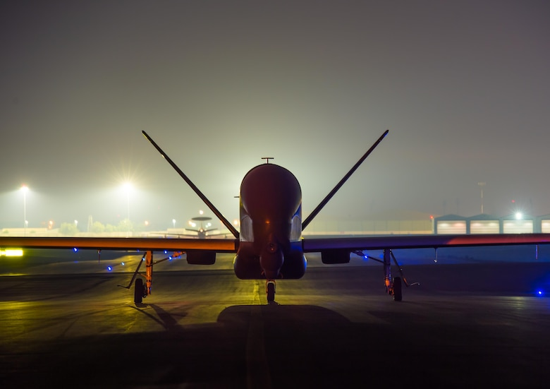 A 380th Air Expeditionary Wing EQ-4 Global Hawk, equipped with a battlefield airborne communications node, taxis before launching a sortie in support of Combined Joint Task Force-Operation Inherent Resolve at an undisclosed location in Southwest Asia, March 31, 2017. BACN has been used to bridge communication multi-national Coalition ground and air assets working to defeat ISIS. (U.S. Air Force/Senior Airman Tyler Woodward)