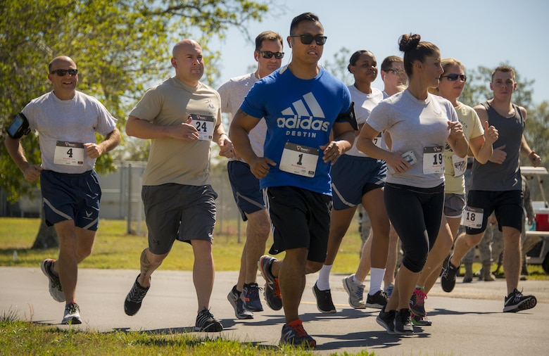 Airmen from the 919th Special Operations Wing begin the Spring 5k run April 1 at Duke Field Fla.  Approximately 25 runners took part in the event.  (U.S. Air Force photo/Lt. Col. James Wilson)