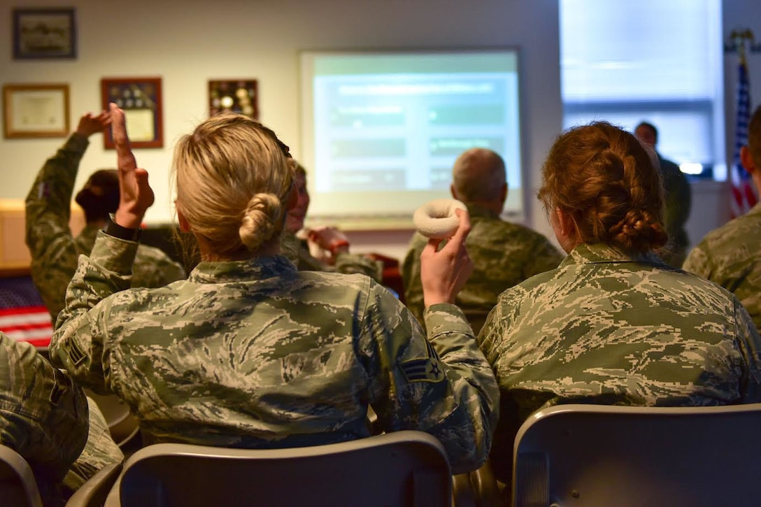 "Members of the 914th Aeromedical Staging Squadron participate in Wingman Day activities Sunday, April 2, 2017 at the Niagara Falls Air Reserve Station, N.Y. The  curriculum consisted of small group, ""healthy connections,"" activities as well as resilience-focused discussions. (U.S. Air Force photo by Staff Sgt. Richard Mekkri)"