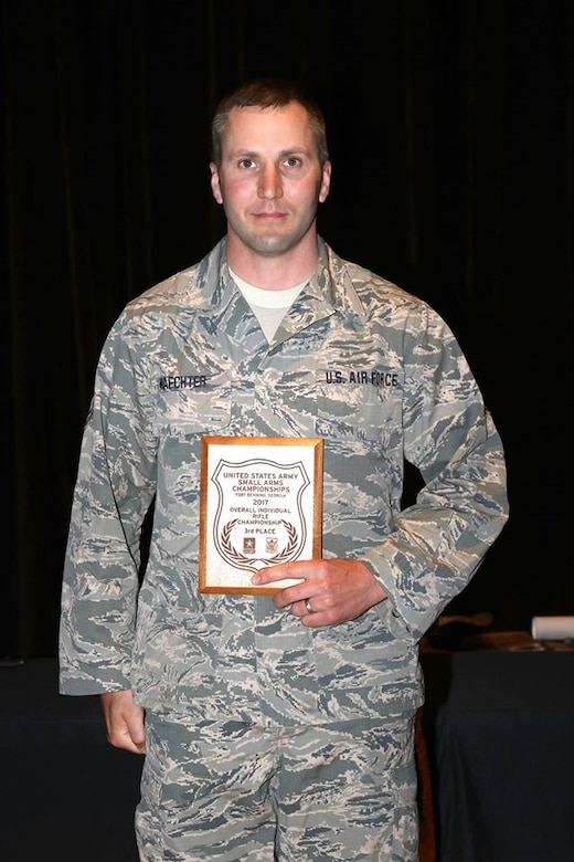 Finishing third place in the individual rife championship is Tech. Sgt. Matthew Waechter. His award was presented by Command Sgt. Major Metheny. The U.S. Army Rifle individual championship is an aggregate of all individual combat rifle matches.