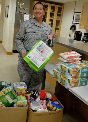 Master Sgt. Rhonda Danyus, 308th Rescue Squadron unit training manager, encourages Airmen to donate nonperishable food and toiletries to the 4th Annual Rescue Feeds Food Drive. Those interested may drop off items in bins located throughout the wing now through April 7, 2017. (U.S. Air Force photo/Senior Airman Brandon Kalloo Sanes)