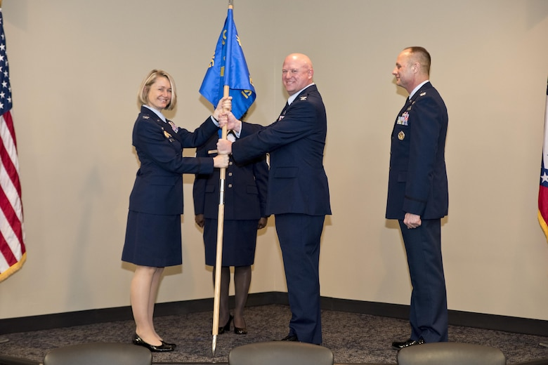 Col. Stanley L. Stefancic III receives the 188th Intelligence, Surveillance and Reconnaissance Group guidon from Col. Bobbi J. Doreenbos, 188th wing commander, during the change of command  ceremony March 1, 2017 at Ebbing Air National Guard Base, Fort Smith, Ark. Stefancic has served 24 years in the intelligence career field and has an extensive background in intelligence support to unit-level operations. (U.S. Air National Guard photo by Senior Airman Matthew Matlock)