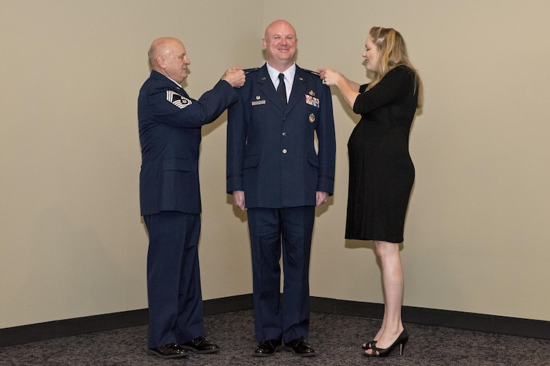 Stanley L. Stefancic III was promoted to the rank of colonel and assumed command of the 188th Intelligence, Surveillance and Reconnaissance Group March 1, 2017 at Ebbing Air National Guard Base, Fort Smith, Ark. Retired Chief Master Sgt. Stanley Stefancic Jr. and Lindsey Stefancic, spouse of Col. Stefancic, place the colonel insignia on Stefancic's service coat.  It is an honorary tradition for the member's family to pin the insignias during an officer's promotion ceremony.  (U.S. Air National Guard photo by Senior Airman Matthew Matlock)