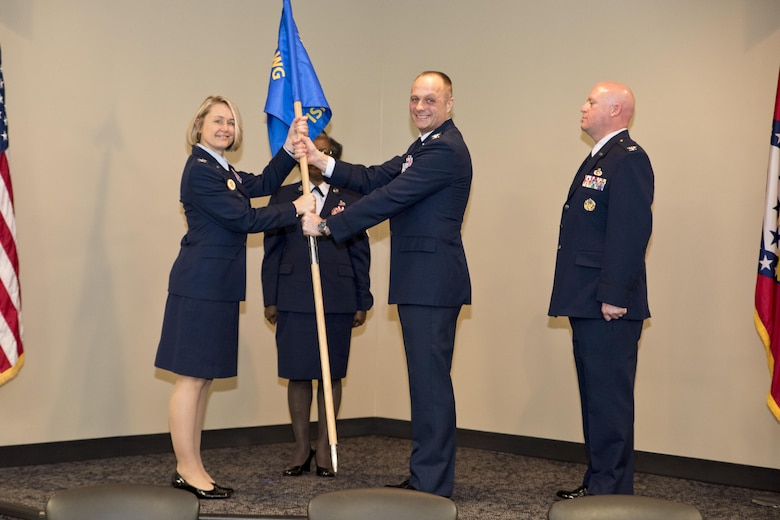 Col. Robert I. Kinney passes the 188th Intelligence, Surveillance and Reconnaissance Group guidon to Col. Bobbi J. Doreenbos, 188th wing commander, during the change of command ceremony March 1, 2017 at Ebbing Air National Guard Base, Fort Smith, Ark.  Kinney's successor, Col. Stanley L. Stefancic III has served 24 years in the intelligence career field and has an extensive background in intelligence support to unit-level operations.    (U.S. Air National Guard photo by Senior Airman Matthew Matlock)