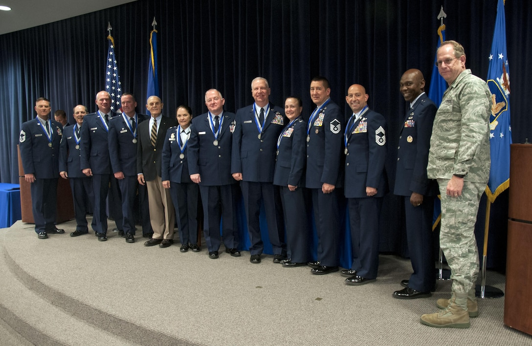"""Ten long-serving members of the Nevada National Guard received recognition Sunday for their decades of service. (from left to right) Chief Master Sgt. Mark Prizina, Chief Master Sgt. Lorne Hall, Col. Glen Martel, Col. Dave Manson,  Major Gen. Drennan A. Clark (ret.), Lt. Col. Shelly Assiff, Senior Master Sgt. Steve Graham, Chief Master Sgt. William Moore, Col. JoAnn Meacham, Master Sgt. Paul Hinen, Chief Master Sgt. Tim Broadway, Assistant Adjutant General, Brig. Gen. Ondra Berry, and The Adjutant General, Brig. Gen. William Burks. Retired Maj. Gen. Drennan A. Clark, former adjutant general of Nevada, helped present the awards, which bear his name, """"The Drennan A. Clark Order of Nevada,"""" during a ceremony at the Air National Guard base here."""