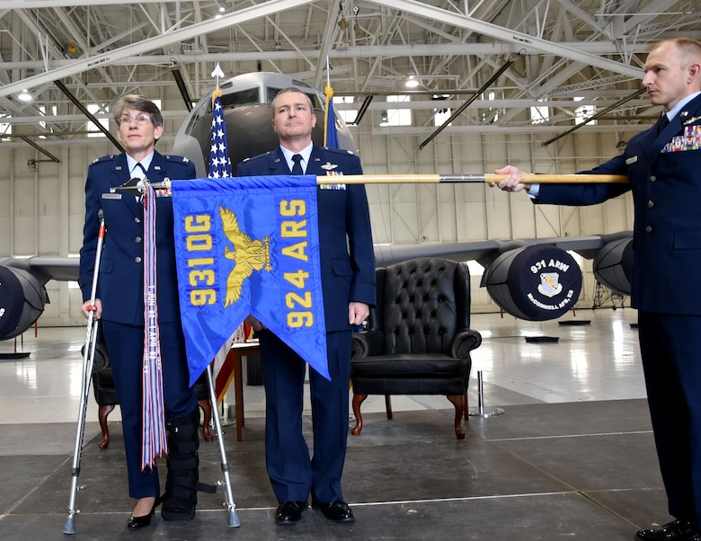 (Left to right) Col. Caroline Evernham, 931st Operations Group commander, Lt. Col. Terry McGee, incoming 924th Air Refueling Squadron commander, and Senior Master Sgt. Jay Guldjord, 18th Air Refueling Squadron boom operator, unfurl the flag signifying the standup of the 924th Air Refueling Squadron April 2, 2017, McConnell Air Force Base, Kan.  The 924th Air Refueling Squadron was last assigned to the 93rd Operations Group at Castle Air Force Base, Calif.  The unit was inactivated April 30, 1992. The 924 ARS at McConnell is the first unit in the Air Force dedicated solely to the KC-46A Pegasus.  The KC-46 is scheduled to arrive later this year.  (U.S. Air Force photo by Tech. Sgt. Abigail Klein)
