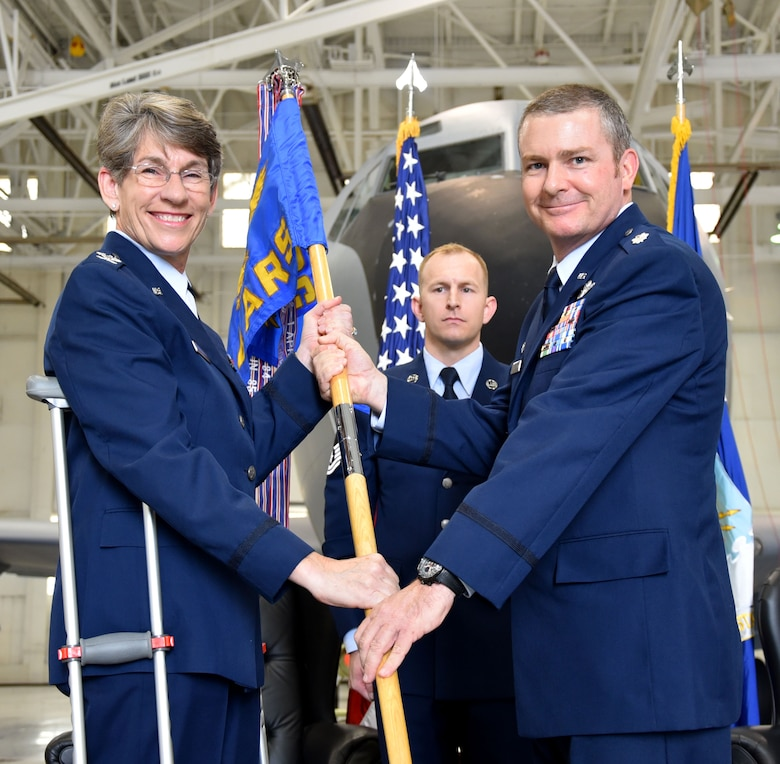 (Left to right) Col. Caroline Evernham, 931st Operations Group commander, hands the guidon to Lt. Col. Terry McGee, 924th Air Refueling Squadron incoming commander, during a standup and assumption of command ceremony April 2, 2017, McConnell Air Force Base, Kan.  McGee is the first commander of the 924 ARS since the unit was inactivated at Castle Air Force Base, Calif., in 1992. The 924 ARS at McConnell is the first unit in the Air Force dedicated solely to the KC-46A Pegasus.  The KC-46 is scheduled to arrive later this year.  (U.S. Air Force photo by Tech. Sgt. Abigail Klein)