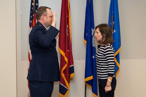 Enlistee Sabina is sworn in by her brother Major Dierk Seifert at the Memphis Air National Guard Base April 2nd 2017.