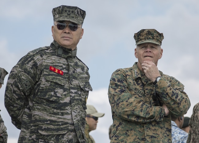 Commandant of the Marine Corps Gen. Robert B. Neller, right, and Republic of Korea (ROK) Marine Corps Lt. Gen. Sang-Hoon Lee, commandant of the ROK Marine Corps, observe an amphibious demonstration at the Pacific Amphibious Leaders Symposium (PALS) 2017, Pohang, South Korea, April 2, 2017. PALS is held annually to help strengthen relationships between allied Marine and Naval forces. (U.S. Marine Corps photo by Cpl. Samantha K. Braun)