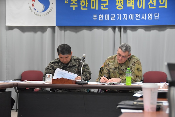 Brig. Gen. Dae-Nam Kang (left), Ministry of National Defense U.S. Forces Korea Relocation Office (MURO) chief and Col. Stephen Bales, US Army Corps of Engineers Far East District commander, take notes during a recent Tier II governance meeting held Mar. 29 at the Medical Resident Office, Camp Humphreys, South Korea. The meeting provided all organizations involved in the completion of the hospital project a chance to sync and discuss a completion date.