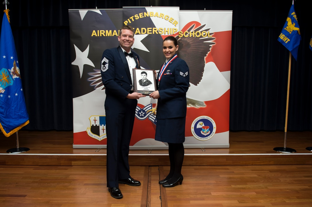U.S. Air Force Senior Airman Luz Sanchez, right, 702nd Munitions Support Squadron emergency action controller, receives the John L. Levitow during the Pitsenbarger Airman Leadership School 17-C graduation at Club Eifel on Spangdahlem Air Base, Germany, Mar. 30, 2017. The Levitow award is the highest honor given to the student who displays excellence in all categories of ALS. (U.S. Air Force photo by Airman 1st Class Preston Cherry)