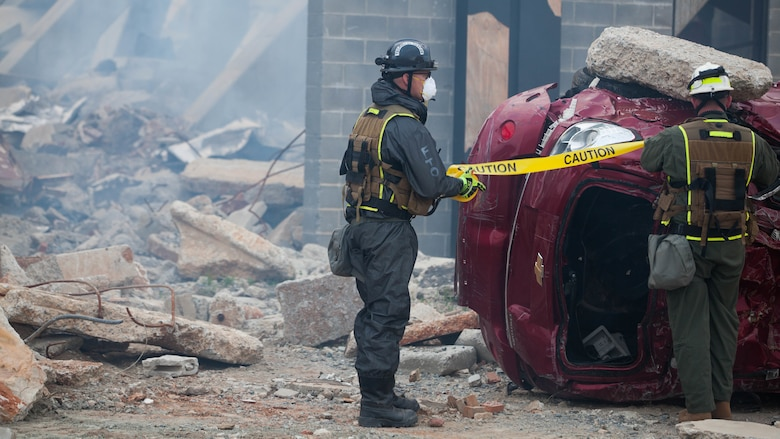 Cpl. Austin Kirby, a Marine with Technical Rescue Platoon, Chemical Biological Incident Response Force, closes off a section of a collapsed building at Guardian Centers in Perry, Georgia, March 23, 2017 during Exercise Scarlet Response 2017.  During a 36-hour field operation, the Marines with CBIRF had to safely extract victims from a collapsed building in the aftermath of a simulated disaster. The field operation is the final event of the exercise.