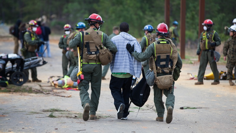Lance Cpl. Valen Campion, left, and Lance Cpl. Carpenter Clark, both Marines with Extraction Platoon, Chemical Biological Incident Response Force, carry a victim to safety at Guardian Centers in Perry, Georgia, March 23, 2017 during Exercise Scarlet Response 2017.  During a 36-hour field operation, the Marines with CBIRF had to safely extract victims from a collapsed building in the aftermath of a simulated disaster. The field operation is the final event of the exercise.