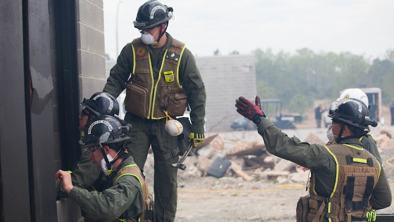 Marines with Technical Rescue Platoon, Chemical Biological Incident Response Force, prop open a pathway into a collapsed building at Guardian Centers in Perry, Georgia, March 23, 2017 during Exercise Scarlet Response 2017.  During a 36-hour field operation, the Marines with CBIRF had to safely extract victims from a collapsed building in the aftermath of a simulated disaster. The field operation is the final event of the exercise.