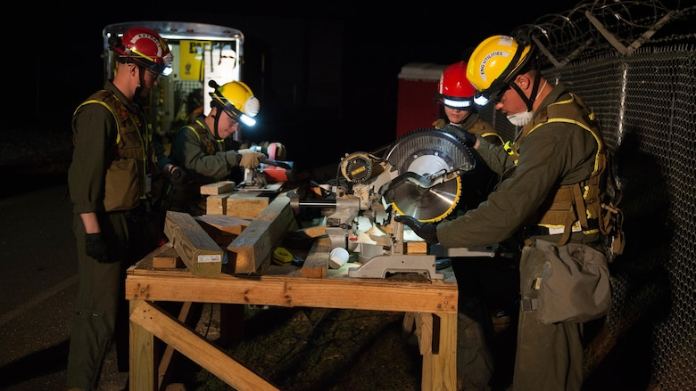 Marines with Engineer Platoon, Chemical Biological Incident Response Force, carve wood at Guardian Centers in Perry, Georgia, March 23, 2017, during Exercise Scarlet Response 2017.  During a 36-hour field operation, the Marines with CBIRF were tested on their ability to perform their skills during nighttime scenarios. Engineering Platoon used wooden planks to support collapsed structures.