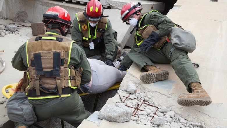 Marines with Chemical Biological Incident Response Force, extract and rescue a victim from a collapsed building at Guardian Centers in Perry, Georgia, March 23, 2017, during Exercise Scarlet Response 2017.  The Marines conducted a search and rescue during a 36-hour field operation in order to extract victims in a simulated disaster. The field operation is the final event of the exercise.