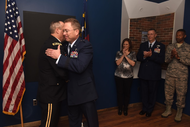 U.S. Army Maj. Gen. Gregory A. Lusk (left), the Adjutant General of North Carolina, commander of the North Carolina National Guard NCNG, congratulates U.S. Air Force Brig. Gen. Thomas J. Kennett (center), the Assistant Adjutant General, Air for the NCNG during an Oath of Office ceremony held at the North Carolina Air National Guard Base, Charlotte Douglas International Airport, April 1, 2017. Kennett joins the NCNG after having served as the Chief of Staff, Air at the Tennessee National Guard and as the airborne emergency action officer for the U.S. strategic command. (U.S. Air National Guard photo by Staff. Sgt. Laura J. Montgomery)