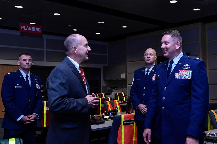 Col. Rob Lyman, right, Joint Base Charleston commander, meets with J. Al Cannon, left, Charleston County sheriff, during a tour of the Charleston County Consolidated 911 Center, March 30, 2017. The Enhanced 911 initiative combines the call centers for the 628th Security Forces Squadron and fire department with the Charleston County Consolidated 911 Center, ultimately shortening response times, saving money and saving lives.