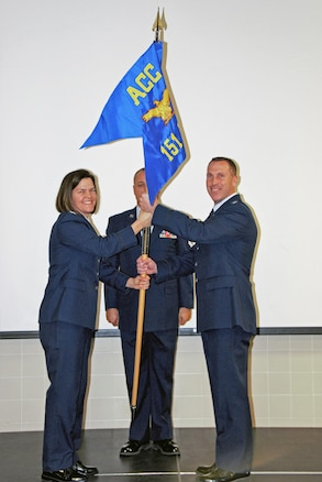 Col. Kristin Streukens, 151st Air Refueling Wing Commander, hands the 151st Intelligence, Surveillance and Reconnaissance Group guidon to Lt. Col. Darrin Ray, 151st ISRG Commander, during the unit stand up ceremony on March 4, 2017 at the Roland R. Wright Air National Guard Base in Salt Lake City. (U.S. Air National Guard photo by Staff Sgt. Nathan Cragun)