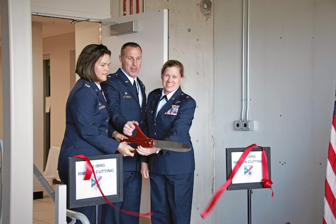 From left: Col. Kristin Streukens, 151st Air Refueling Wing Commander, Lt. Col. Darrin Ray, 151st Intelligence, Surveillance and Reconnaissance Group Commander,  and Brig. Gen. Christine Burckle, Utah Air National Guard Commander, cut the ribbon during the 151st ISRG unit stand up ceremony on March 4, 2017 at the Roland R. Wright Air National Guard Base in Salt Lake City. (U.S. Air National Guard photo by Staff Sgt. Nathan Cragun)