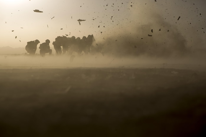 U.S. Marines with 2nd Battalion, 6th Marine Regiment and 2nd Combat Engineer Battalion, take cover from shrapnel behind a blast blanket while conducting urban demolition breach training for Talon Exercise 2-17, Yuma, Arizona, March 30, 2017. The purpose of TalonEx was for ground combat units to conduct integrated training in support of the Weapons and Tactics Instructor Course 2-17 hosted by Marine Aviation Weapons and Tactics Squadron One.