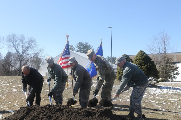 Col. Barron and the rest of the official party break ground on the Hanscom Air Force Base Dormitory construction, March 13, 2017.