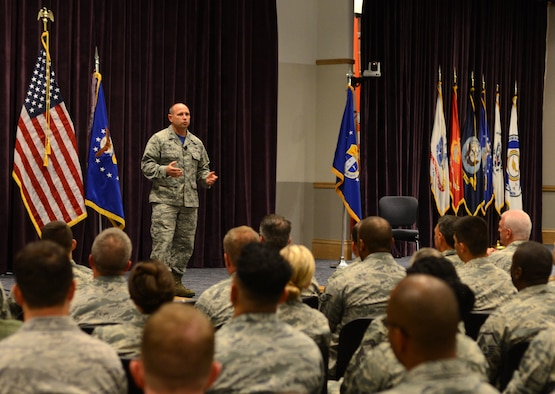 Col. Kurt Matthews, 920th Rescue Wing commander, speaks to Reserve Airmen during his first commander's call April 2, 2017 at Patrick Air Force Base, Fla. Matthews took command of the Air Force Reserve's only combat search-and-rescue wing in December 2016. (U.S. Air Force photo by Staff Sgt. Jared Trimarchi)