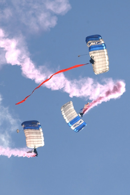 Wings of Blue team members parachute in to a Falcon Stadium home game during pregame ceremonies at the U.S. Air Force Academy. The Academy parachute team will bring in the U.S. flags at the Texas Rangers home opener in Arlington, Texas, April 3, 2017. (U.S. Air Force photo/John Van Winkle)
