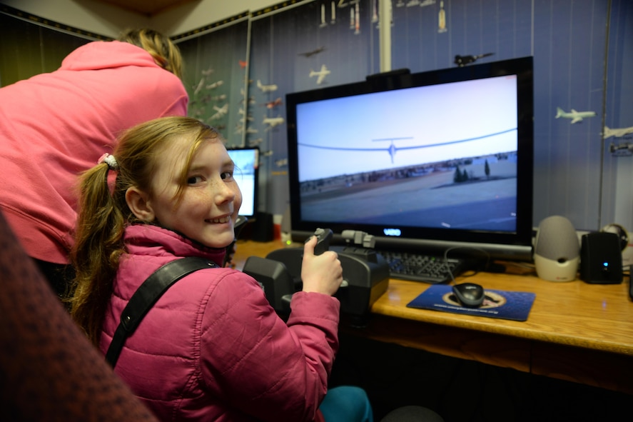 Julianna Gorton, daughter of retired U.S. Air Force Master Sgt. Richard Gorton and Aime Gorton, hones her glider skills at the Curtis E. LeMay Composite Squadron's open house March 30 at their squadron headquarters. The event showcased a new state-of-the-art cybersecurity and science, technology, engineering and mathematics (STEM) learning environment made possible by grants from a local corporate sponsor, the Offutt Officers' Spouses' Club and an anonymous donor.  About 56,000 members make up CAP, which celebrated 75 years of service on Dec. 1, 2016, and consists of eight geographical regions, composed of 52 separate wings, one in each state, and Washington D.C. and Puerto Rico. The organization operates a fleet of 550 aircraft and performs about 90 percent of continental U.S. inland search and rescue missions as tasked by the Air Force Rescue Coordination Center. CAP is credited with saving an average of 78 lives every year.