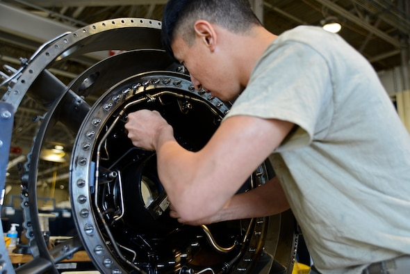 U.S. Air Force Senior Airman Monhuan Lee, 20th Component Maintenance Squadron aerospace propulsion journeyman, tightens a bolt on a fan frame at Shaw Air Force Base, S.C., March 29, 2017. The fan frame makes up part of the F110-129D engine as a support fan. (U.S. Air Force photo by Airman 1st Class BrieAnna Stillman)