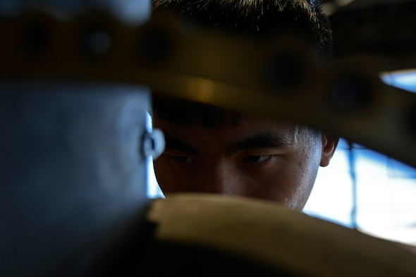 U.S. Air Force Senior Airman Monhuan Lee, 20th Component Maintenance Squadron aerospace propulsion journeyman works on the number three sump housing, which houses part of the F110-129D engine at Shaw Air Force Base, S.C., March 29, 2017. The number three sump housing is one of five sump housings that will be used when reassembling the F110-129D engine. (U.S. Air Force photo by Airman 1st Class BrieAnna Stillman)
