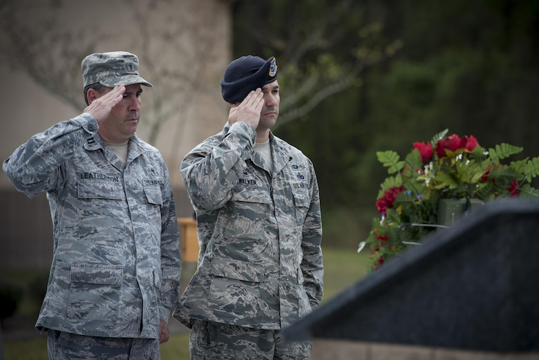 Chaplain (Capt.) Todd Leathermon, 93d Air Ground Operations Wing chaplain, left, and Col. Kevin Walker, 820th Base Defense Group commander, right, salute a wreath and memorial during the 820th BDG anniversary, March 27, 2017, at Moody Air Force Base, Ga. The anniversary commemorated 20 years since the activation of the 820th BDG and allowed guests to reminisce on their history, honor those they've lost, and witness a tactical demonstration. (U.S. Air Force photo by Airman 1st Class Lauren M. Sprunk)