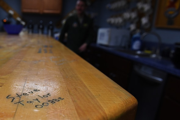 Lt. Col. Stephen Taylor's, 334th Fighter Squadron assistant director of operations, signature is etched on a table he constructed for the squadron, March 30, 2017, at Seymour Johnson Air Force Base, North Carolina. Taylor reached 3,000 flight hours in the F-15E Strike Eagle and both started and ended his career at Seymour Johnson AFB. (U.S. Air Force photo by Airman 1st Class Victoria Boyton)