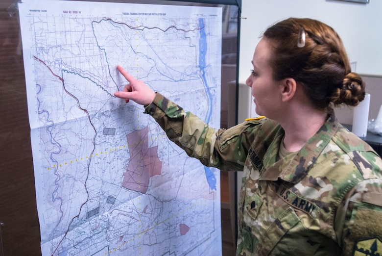 Meet Spc. McTimmonds! Spc. Tara M. McTimmonds, a geospatial engineer with Headquarters and Headquarters Company, 301st Maneuver Enhancement Brigade, identifies a location on a map of Yakima Training Center (YTC), at Joint Base Lewis-McChord, Washington, February 12, 2017. Geospatial engineers produce the maps that will support the commander's next mission, and are a vital component of the Army, Army Reserve, and Total Force (U.S. Army Reserve photo by Spc. Sean Harding/Released).