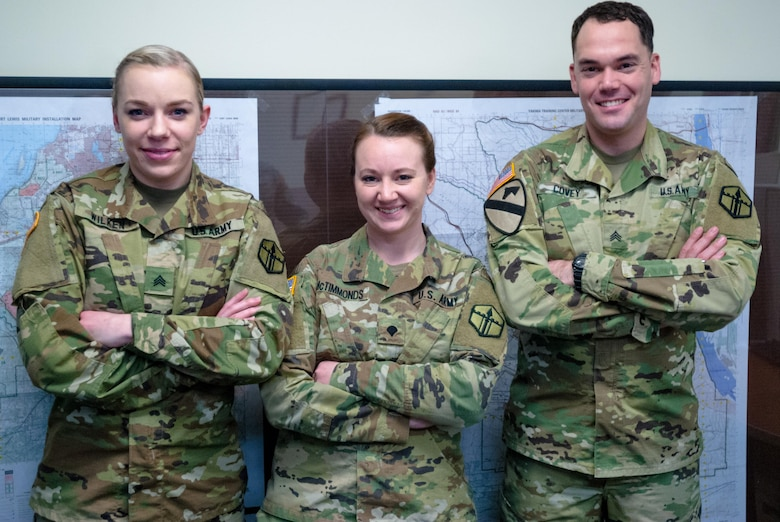 From left: Sgt. Morgan T. Wilken, Spc. Tara M. McTimmonds, Sgt. Noel A. Covey, pose for a photograph at 301st Maneuver Enhancement Brigade (MEB) headquarters, Joint Base Lewis-McChord, Wash. February 12, 2017. Geospatial engineers produce the maps that will support the commander's next mission, and are a vital component of the Army, Army Reserve, and Total Force (U.S. Army Reserve photo by Spc. Sean Harding/Released).