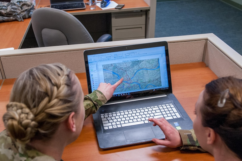 Sgt. Morgan T. Wilken identifies a location in ArcMap at the 301st Maneuver Enhancement Brigade headquarters, Joint Base Lewis-McChord, Washington, Feburary 12, 2017. Geospatial engineers produce the maps that will support the commander's next mission, and are a vital component of the Army, Army Reserve, and Total Force (U.S. Army Reserve photo by Spc. Sean Harding/Released).